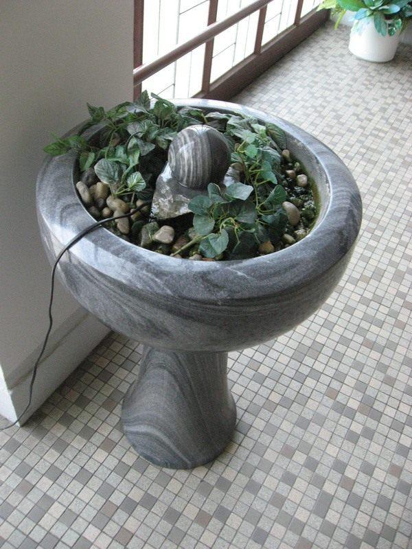 Цветочный вазон из натурального камня с фонтаном